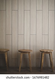 wood texture on wall and wood chair.