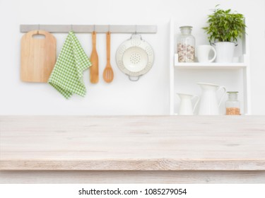 Wood texture table over blurry kitchen wall and shelf background