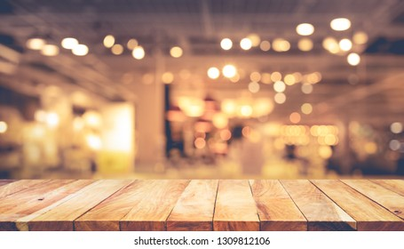 Wood texture table top (counter bar) with blur light gold bokeh in cafe,restaurant background.For montage product display or design key visual layou