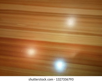 Wood texture with three spots of celling lights