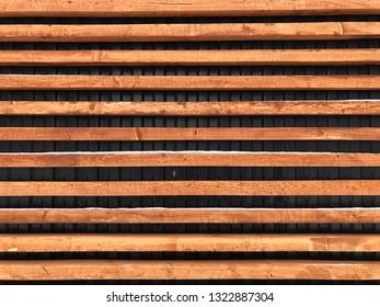 wood texture. wooden slats are located along. wooden background. Background of wooden slats