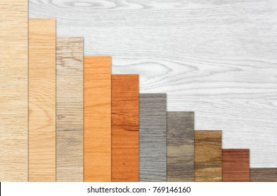 Wood textured graph bars in linear descending order over a white wood background