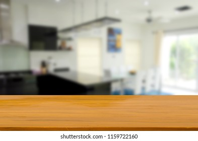 wood top table and Abstract Blurred kitchen room. Can be used for display or montage your products.