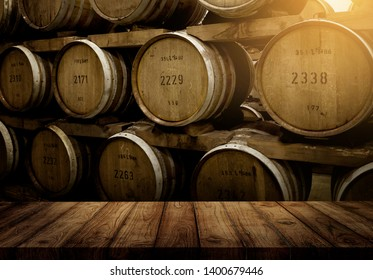 wood top table and oak wood barrel background