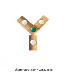Wood toy in alphabet over white background.