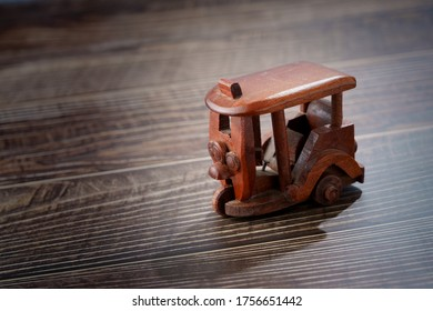 Wood toy tricycle on wood table background