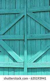 The wood turquoise colored shutters