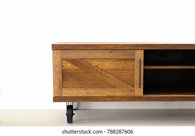 Wood TV stand in living room with white wall in loft style