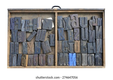 Wood Type Mixture in a desk drawer isolated on white with clipping path