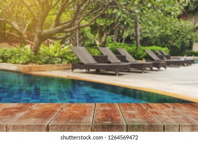 wood walk and Poolside loungers at an exotic asian hotel.