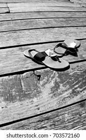 wood walkway texture background with shoes in black and white