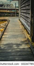 wood walkway to traditional dock