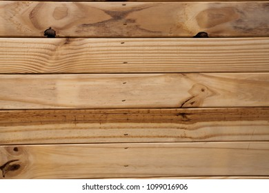 Wood Wall Texture Background color old brown and light brown. The wood is stacked as pettern, panel, art, and decored. It can be used for background or text.