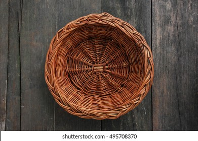 wood weave fruit basket on wood texture, top view
