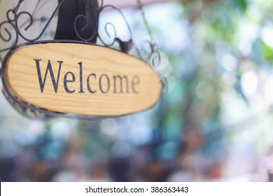 wood welcome sign hanging. selective focus.