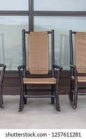 Wood and Wicker Rocking Chairs in front of building