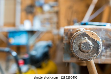 Wood workbench in carpentry workshop, focus on the wise, shallow depth of field.