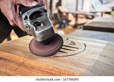 Wood worker carving wood