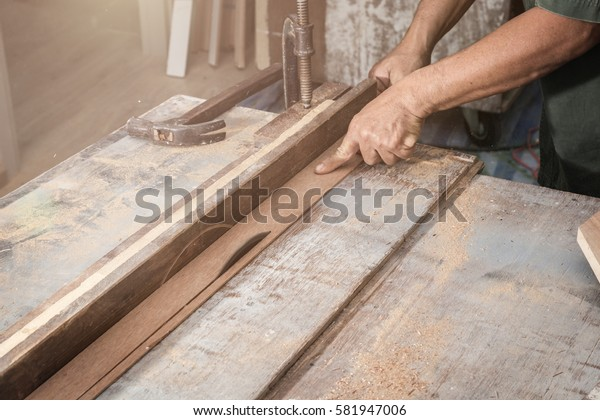 wood workshop with handcraft tools and raw wood on construction site