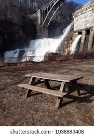 woodbench on front of waterfall
