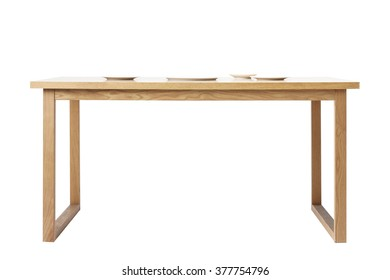 The wood(birch, ply) table(desk) with many white empty(blank, vacant, hollow) dish, no food isolated white at the studio.