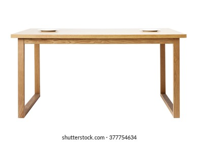 The wood(birch, ply) table(desk) with two white empty(blank, vacant, hollow) dish, no food isolated white at the studio.