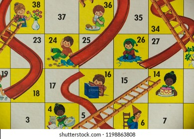 Woodbridge, New Jersey / United States - October 9, 2018: A circa 1980s board game of Chutes and Ladders is shown.