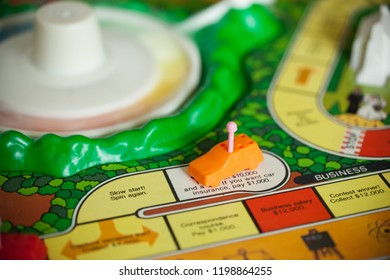 Woodbridge, New Jersey / United States - October 9, 2018: A circa 1980s board game of Life is shown with colorful pawns and background