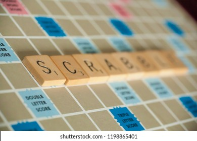 Woodbridge, New Jersey / United States - October 9, 2018: A vintage Scrabble board game is shown with letter tiles spelling out Scrabble