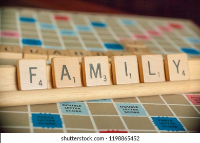 Woodbridge, New Jersey / United States - October 9, 2018: A vintage Scrabble board game is shown with letter tiles spelling out Family.