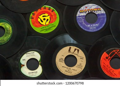 Woodbridge, New Jersey / United States - October 11, 2018: A collection of 1960s 45 speed records, including the Beatles, Don McLean, Four Tops, Aretha Franklin, and Creedence Clearwater Revival.