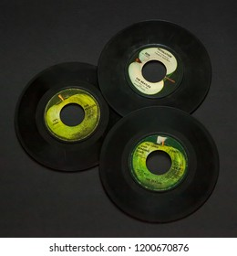 Woodbridge, New Jersey / United States- October 11, 2018: A collection of 1960s Beatles 45 speed records including Hey Jude, Revolution, and the Long and Winding Road.