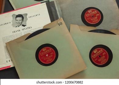 Woodbridge, New Jersey / United States - October 11, 2018: 1940s era Frank Sinatra 78 RPM records on a black background.