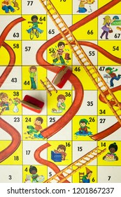 Woodbridge, New Jersey / United States - October 13, 2018: A circa 1980s board game of Chutes and Ladders is shown.