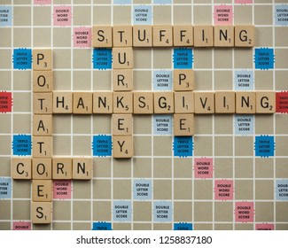 Woodbridge, New Jersey / United States - November 9, 2018: Scrabble tiles spell out various Thanksgiving foods on a vintage board