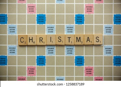Woodbridge, New Jersey / United States - November 9, 2018: Scrabble tiles spell out the word Christmas on a vintage game board