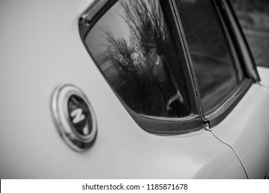Woodbridge, Virginia, USA - December 26, 2016 - Datsun 240z Exterior Side View Window Reflection Outside White Classic Vintage Antique Car