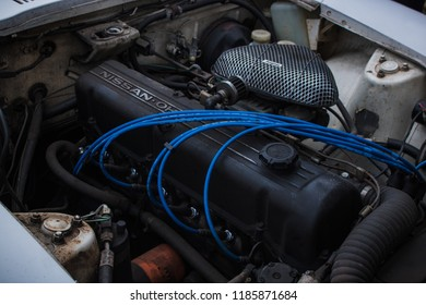 Woodbridge, Virginia, USA - December 26, 2016 - Datsun 240Z Motor Blue Spark Plug Cables And Aftermarket Air Filter Vintage Antique Classic Car Engine Inline Six 6 Cylinder Carburetor