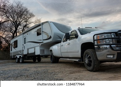 Woodbridge, Virginia, USA - March 15, 2018 - Fifth Wheel RV Recreation Vehicle 5th Slides Out Pulled By Diesel Truck Towing Camper Trailer