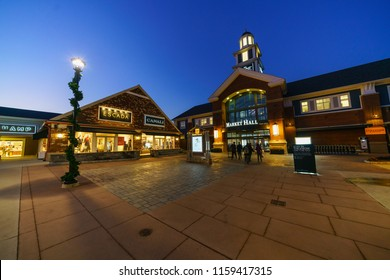 WOODBURY, NEW YORK - NOV 14 : Outlet shops in Woodbury Common Premium Outlet at twilight on Nov 14, 2017 in Woodbury, New York, USA.