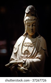 a woodcarving of Buddha