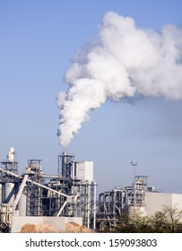 Woodchip production polluting the atmosphere with smoke and smog