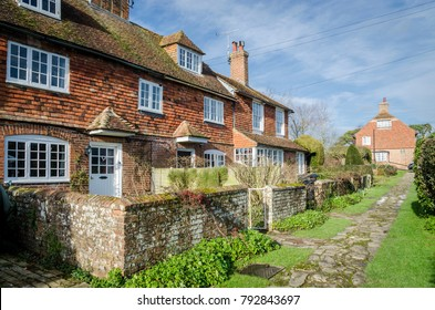 WOODCHURCH, KENT, UK, 25 JANUARY 2016 - Row of brick and tiled cottages in a village in Kent, UK