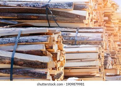 Woodcut of freshly cut lumber awaiting distribution as biomass for heating sezon. - Shutterstock ID 1909879981