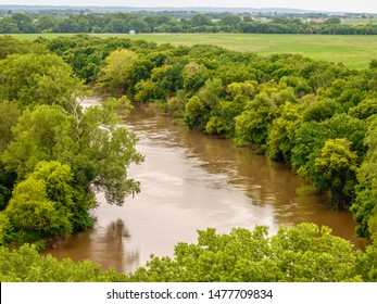 Wooded bend in Big Sioux River, seen from overlook in Stone State Park, Sioux City, Iowa, USA, on a summer afternoon