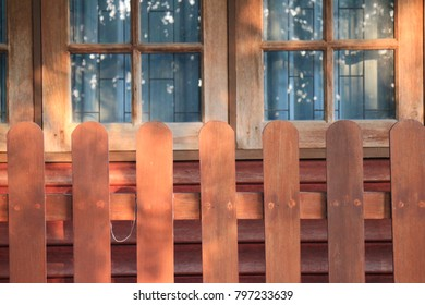 wooded fence and windows of thai house