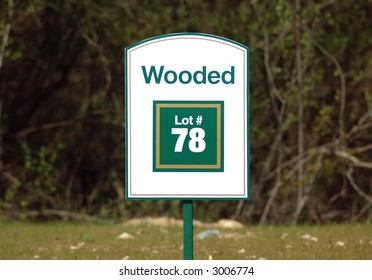 Wooded lot sign