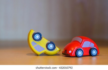 Wooded toy car  are crashed. Accident