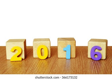 wooden 2016 on wooden block on isolate white background
