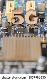 Wooden '5G' symbol on computer motherboard. Conceptual 5th generation wireless system image.